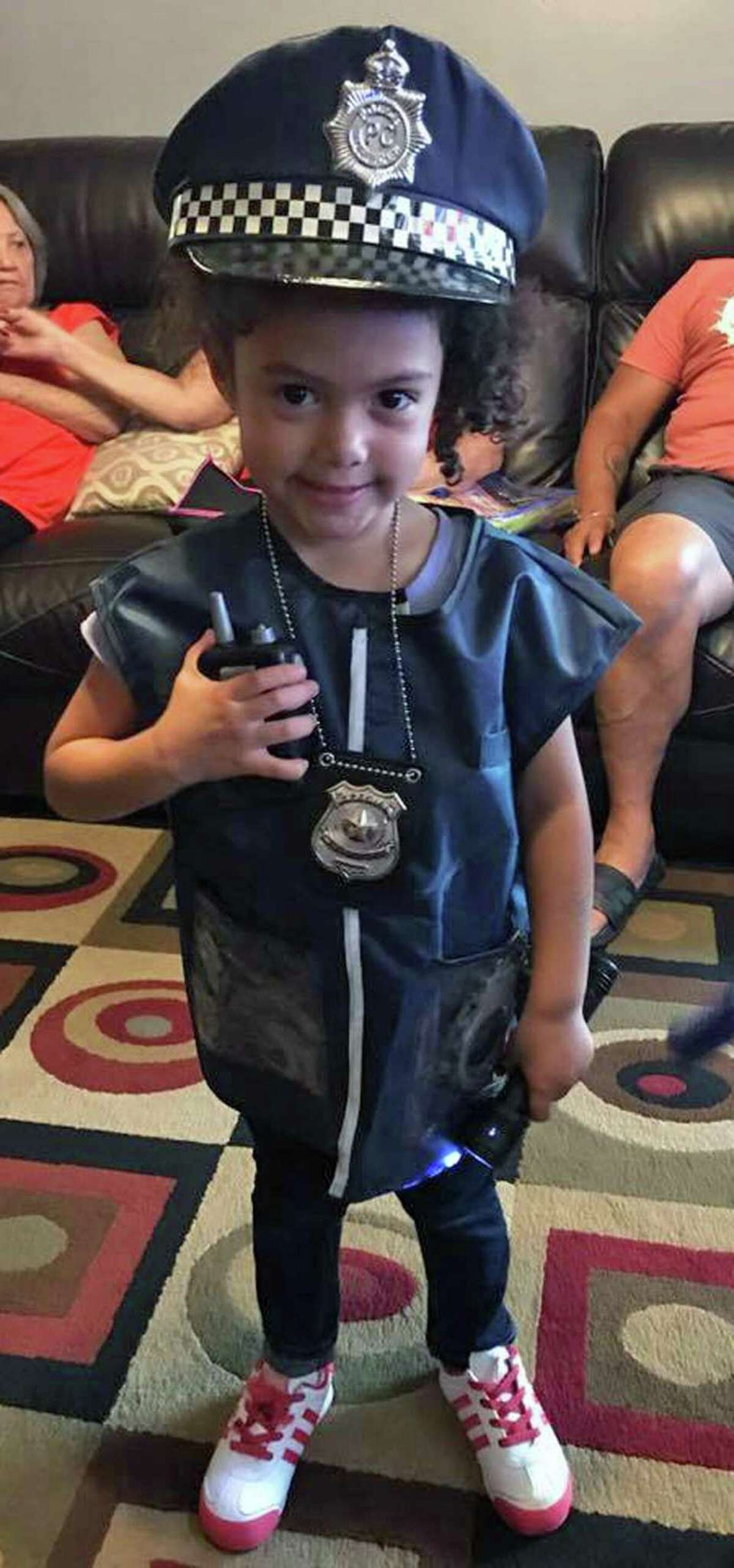 4-year-old Saydie Ramos, of Bridgeport, Conn., poses in her new police uniform. The uniform was purchased by her father, Alex Ramos, and delivered to her by Bridgeport police officers on Sept. 7, 2017.