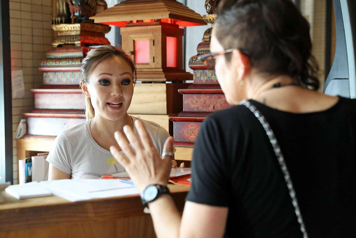 Kathy Fang answers a menu question at Fang on Howard in San Francisco, Calif., on Sunday, September 11, 2017.