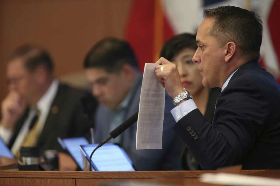 During a discussion of the 2018 fiscal year budget on Thursday, Sept. 14, 2017, San Antonio City Council Member from District 6 Greg Brockhouse holds up an email from the night before dropping a project in his district. The council and Mayor Ron Nirenberg went on to approve a $2.7 billion budget. Photo: JERRY LARA / San Antonio Express-News / San Antonio Express-News