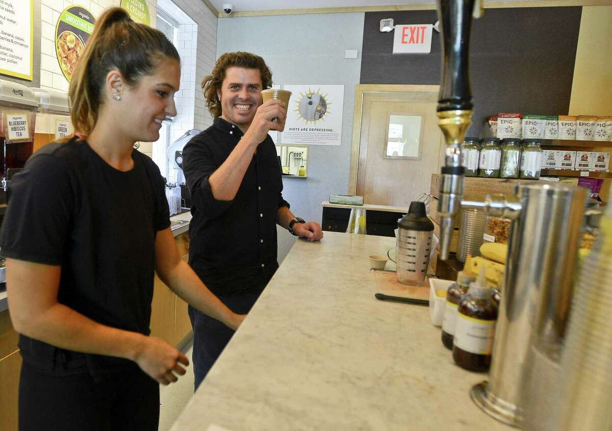 Jarrett McGovern, co-founder of Rise Coffee Company, lifts a Mexican Mocha specialty drink made with Rise Nitro Cold Brew Original Black coffee, Almond Mylk, Cocoa, Cinnamon, Cayenne and Agave. It was prepared by Madison Caan, a Team Member at Green and Tonic, a healthy food and juice store in Greenwich, Connecticut on Wednesday, August 30, 2017.