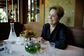"""In this Aug. 25, 2017, photo, Alice Waters, founder of Chez Panisse restaurant, listens to questions during an interview at the restaurant in Berkeley, Calif. Waters' journey from a childhood of 1950s convenience cooking to the pinnacle of American cuisine is the subject of her new memoir, """"Coming to My Senses: The Making of a Counterculture Cook."""" (AP Photo/Eric Risberg) ORG XMIT: FX905"""