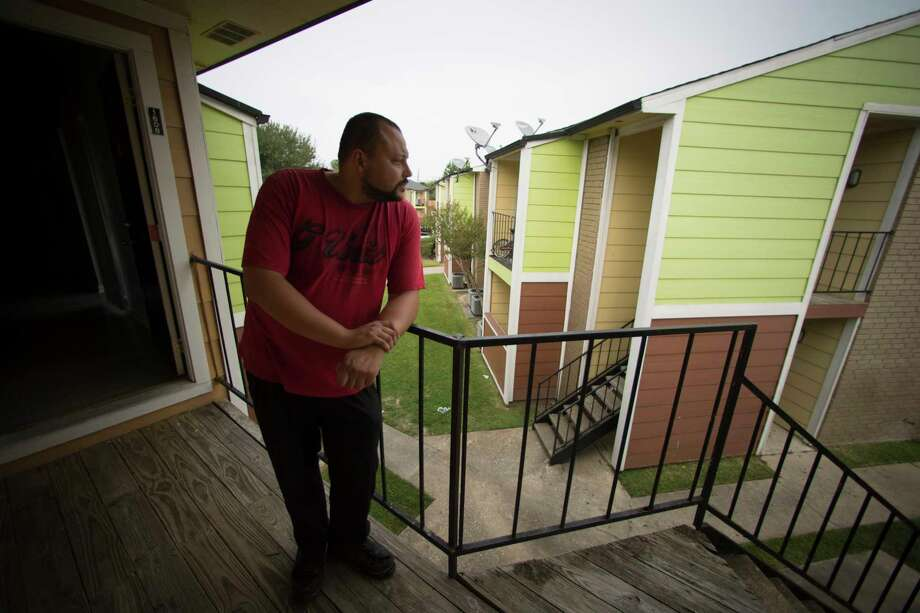Steven Calhoun, 31, stands on the balcony of his apartment north of Houston, Wednesday, Sept. 13, 2017. Calhoun missed five days at his job packing airplane meals at George Bush Intercontinental Airport, and now is facing an eviction notice, on top of struggling to afford food. He's applied for FEMA aid and disaster unemployment insurance, but that takes weeks to process. Photo: Marie D. De Jesus, Houston Chronicle / © 2017 Houston Chronicle