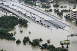 Interstate 10  is shown blocked by floodwaters from Tropical Storm Harvey on Tuesday, Aug. 29, 2017, in Houston.
