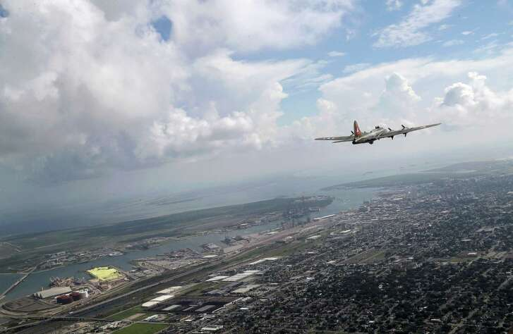 A B-17 bomber flies over the coast near Texas City as the Lone Star Flight Museum relocates from Galveston Island to its new headquarters at Ellington Field.