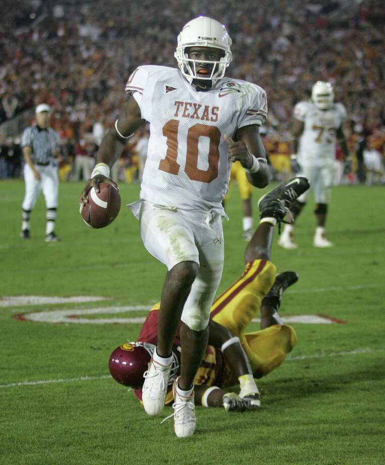 FILE - In this Jan. 4, 2006, file photo, Texas quarterback Vince Young rushes for the game-winning touchdown against Southern California during the Rose Bowl college football game in Pasadena, Calif. When Texas and Southern California last met on the football field, the Longhorns and Trojans put on a show many still call the greatest game in college football history. Texas (1-1) and No. 4 USC (2-0) meet again on Saturday night, Sept. 16, 2017. (AP Photo/Paul Sakuma, File) Photo: PAUL SAKUMA, STF / 2006 AP