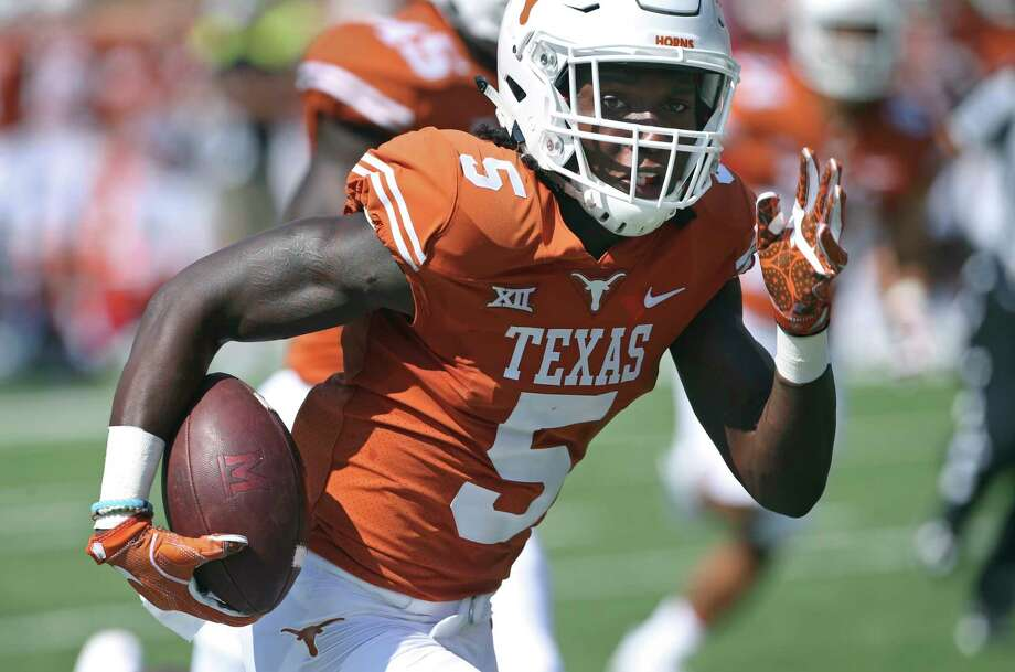 Longhorn defensive back Holton Hill heads for the end zone with an interception as Texas plays Maryland at DKR Stadium on September 2, 2017. Photo: Tom Reel, Staff / 2017 SAN ANTONIO EXPRESS-NEWS