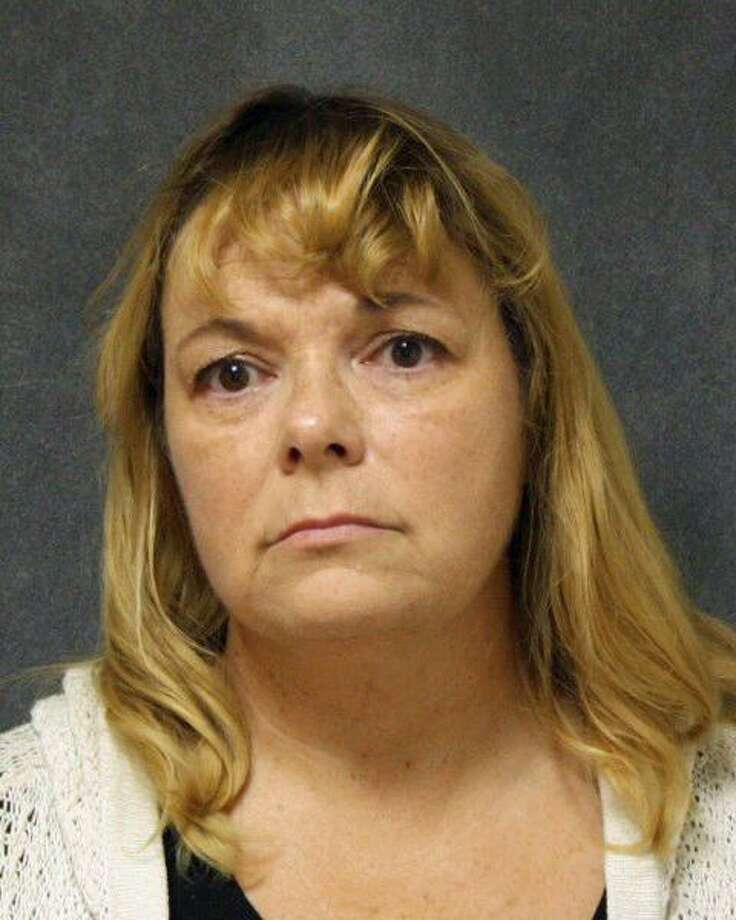 Leslie Laing, 48, of Milford, Conn., was charged with violation of a protective order by after she turned herself in on an active warrant Thursday afternoon, Ansonia police said. Photo: Contributed Photo / Ansonia Police Department / Contributed Photo / Connecticut Post Contributed