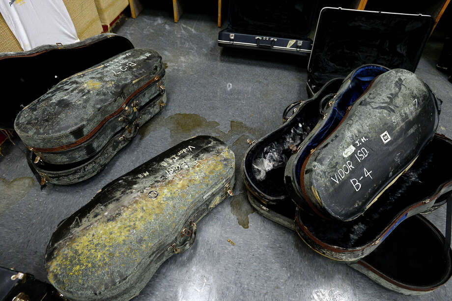 Moldy instrument cases in the band room at Vidor Middle School on Thursday. The school's fifth graders will go to class in a separate wing at Vidor High School, and the sixth graders will go to the junior high.  Photo taken Thursday 9/14/17 Ryan Pelham/The Enterprise Photo: Ryan Pelham / ©2017 The Beaumont Enterprise/Ryan Pelham