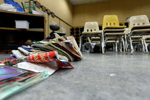 Damaged books dry in the band room at Vidor Middle School on Thursday. The school's fifth graders will go to class in a separate wing at Vidor High School, and the sixth graders will go to the junior high.  Photo taken Thursday 9/14/17 Ryan Pelham/The Enterprise