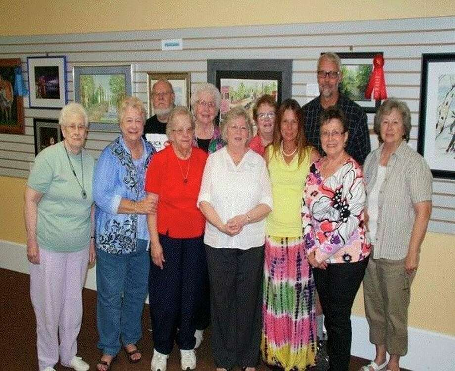 Gladwin Area Artist Guildart show winners in 2016. Front, from left,Veryl Yenior, Shareen Lenders, Mary Marcum, Sheila Auer, Lora Perkins, Pat Holzhausen andCora Hartman. Back, from left, Ron Smith for Jo Ann Morgan Smith, Mary Hynes, Mary Fitzgerald and Bill Rievert.(Photo provided)