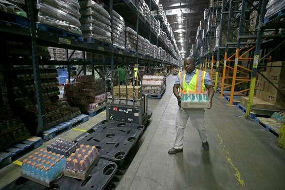 Anthony Burks, grocery order selector, works in the Kroger Distribution Center, 701 Gellhorn, Tuesday, Sept. 12, 2017, in Houston. ( Melissa Phillip / Houston Chronicle )
