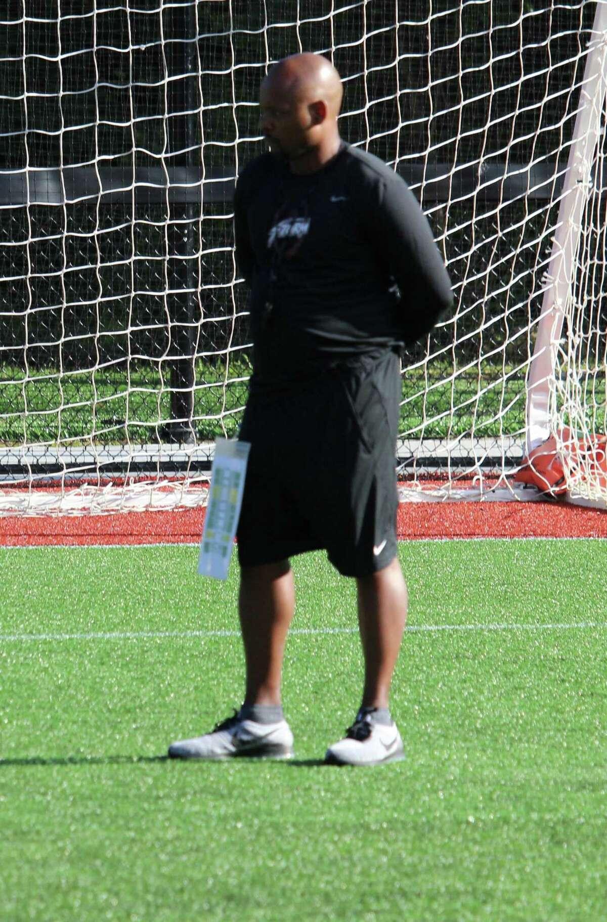 St. Luke's coach Noel Thomas looks on during practice.