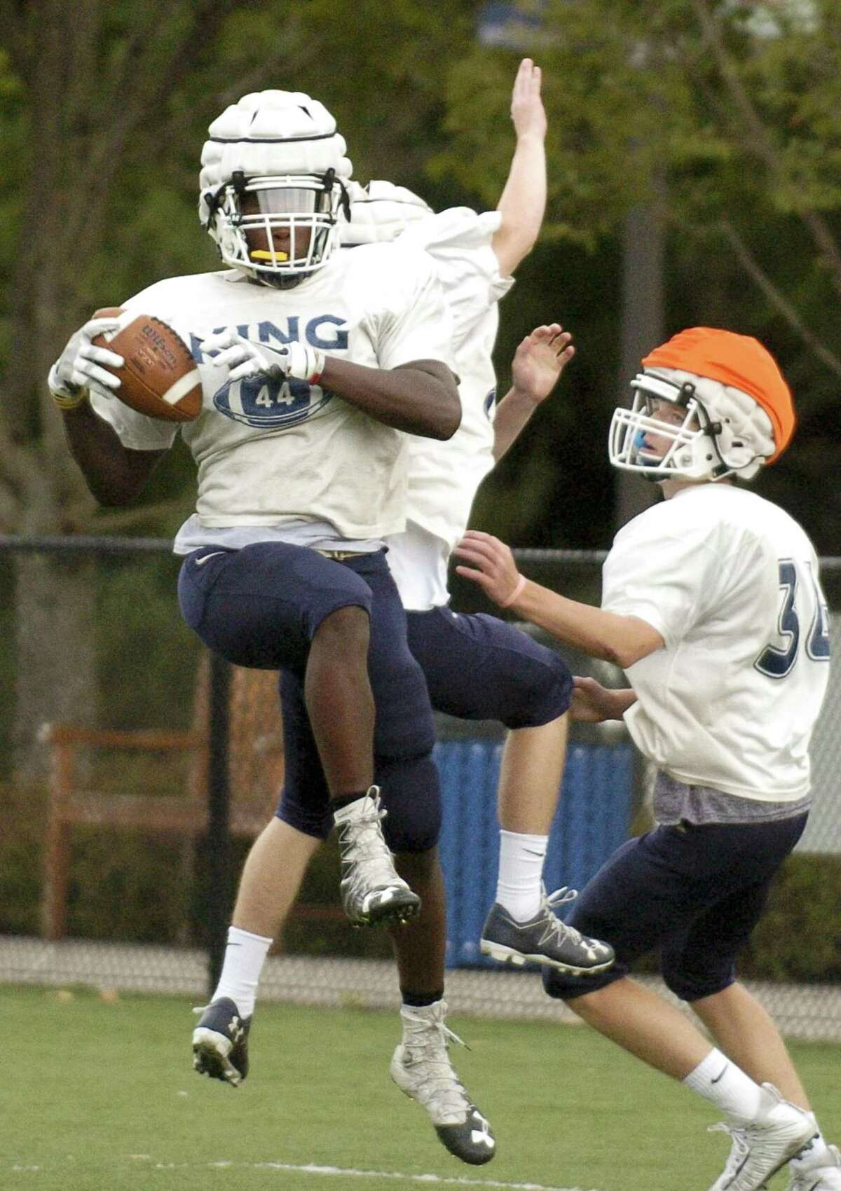 King outside linebacker Levaughn Lewis makes a reception during a practice at the school on Wednesday in Stamford.
