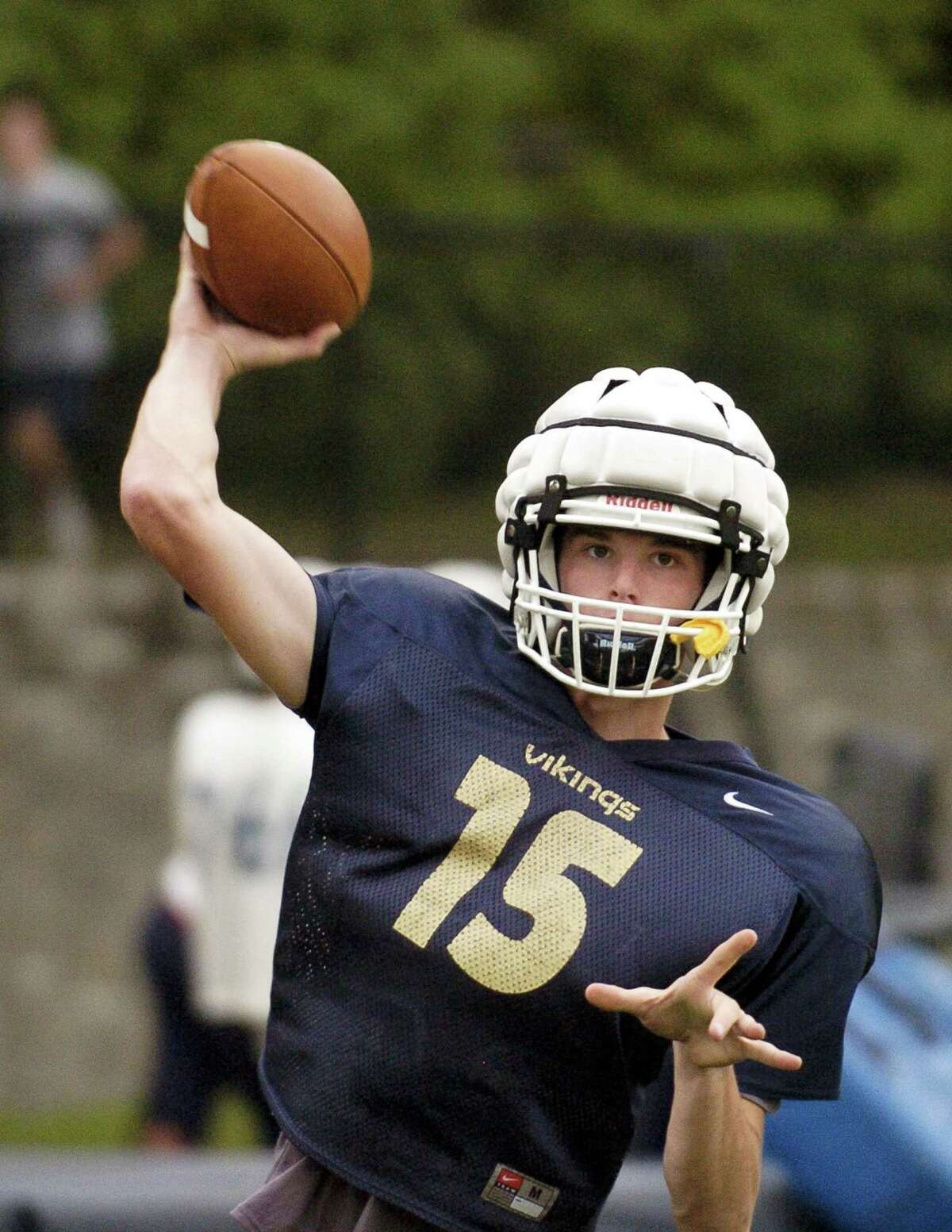 King quarterback Renn Lints warms up during a team practice at the school on Wednesday in Stamford.