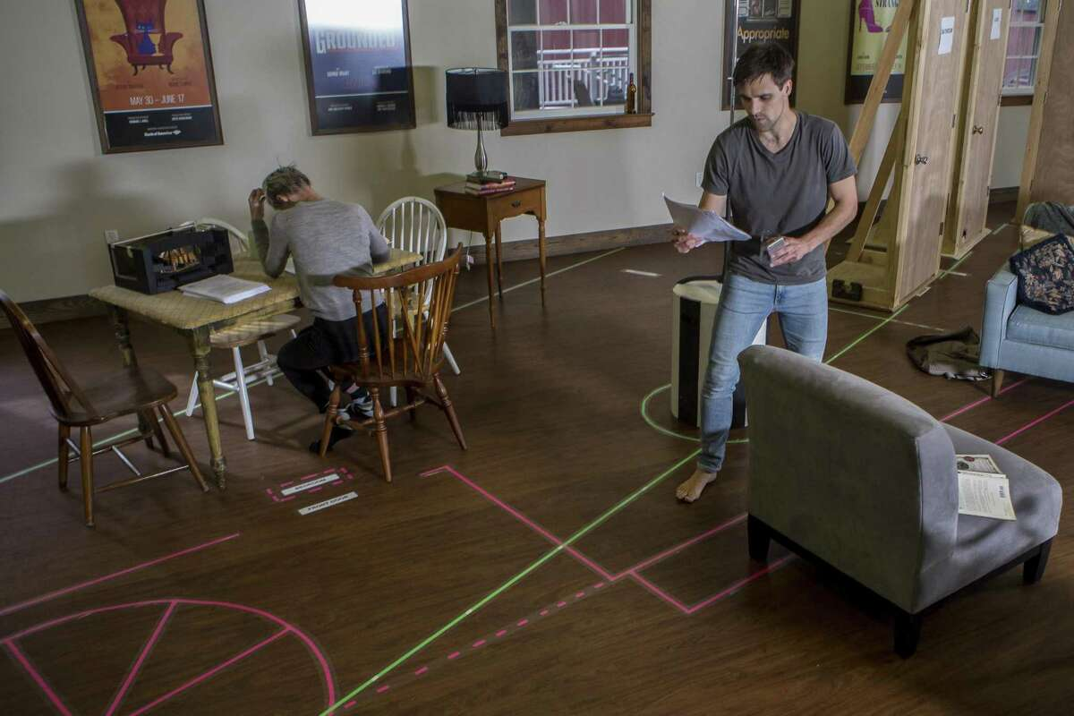 Actor Chris Ghaffari practices staging with Jessica Love for