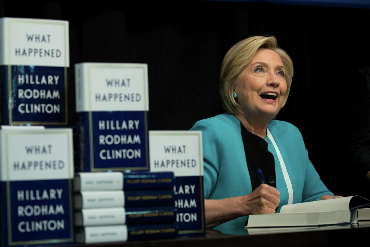 Former U.S. Secretary of State Hillary Clinton signs copies of her new book