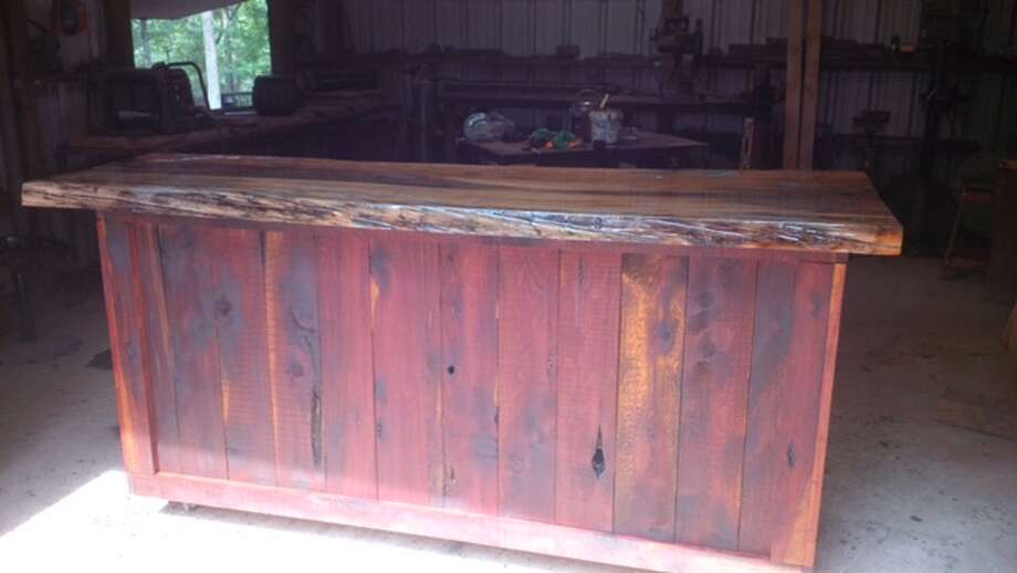 Hundreds are expected to turn out to this year's Legend of the Lion event hosted by the Conroe Noon Lions Club. Some of the auction items include a hand-made wooden patio bar (pictured), chicken coop, trips and firearms. Photo: Submitted Photo