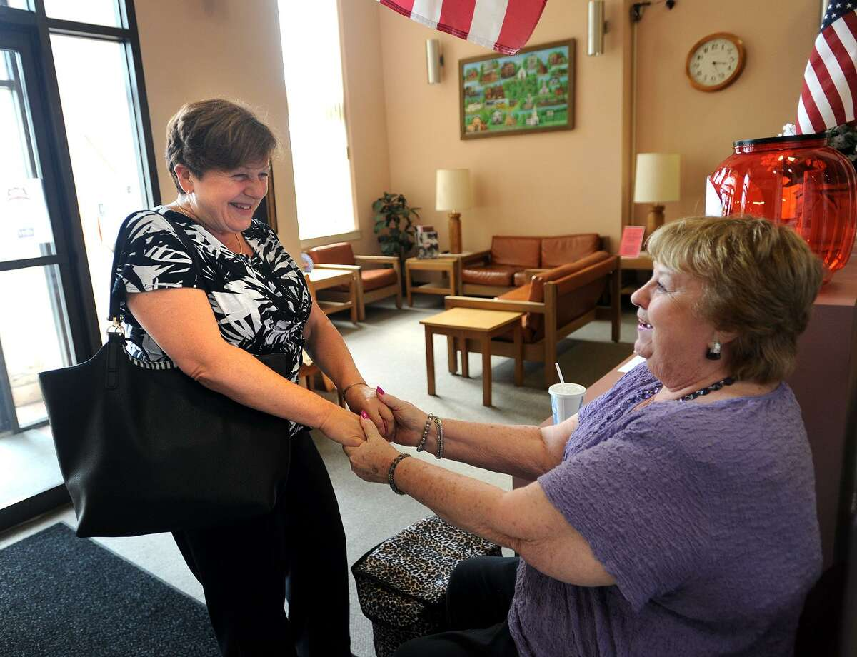 Derby Mayor Anita Dugatto, left, is congratulated on her victory in Tuesday's primary by supporter Charlotte Ritter during a visit to the Derby Senior Center on Thursday, September 14, 2017. Dugatto received a lot of support from the senior community in the city.