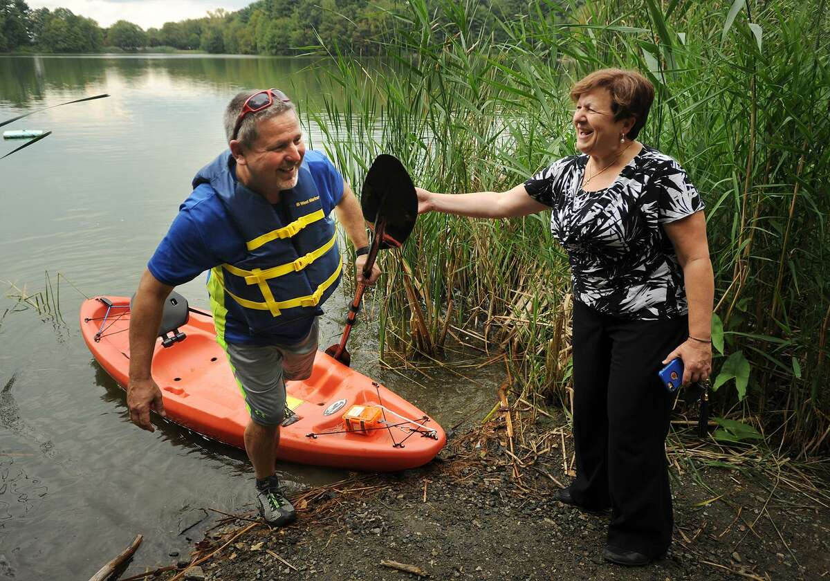 Alderman Art Gerckens of Derby's 2nd Ward is greeted by Mayor Anita Dugatto as he climbs from his kayak at Witek Park in Derby, Conn. on Thursday, September 14, 2017.