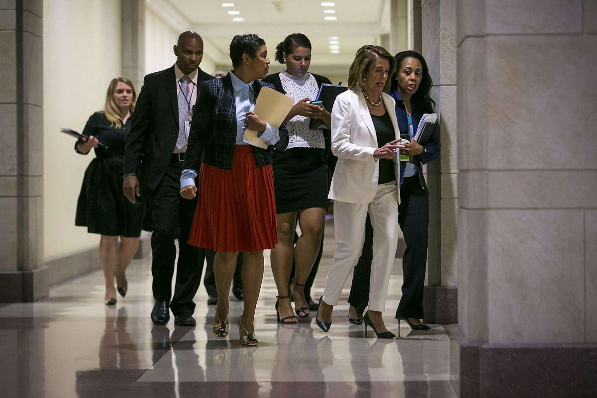House Minority Leader Nancy Pelosi (D-Calif.) arrives with her staff to a news conference on Capitol Hill, in Washington, Sept. 14, 2017. After a dinner meeting the night before with Pelosi and Senate Minority Leader Chuck Schumer (D-N.Y.), President Donald Trump confirmed Thursday morning that he supports legislation that would protect young undocumented immigrants from deportation and would deliver a �massive� increase in border security � but not with a wall on the southern border. (Al Drago/The New York Times)