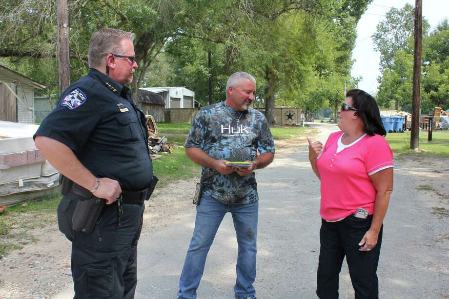 Patton Village Police Chief Shannon Sharp visits with cousins Clint Talley and Audrey Smith during door-to-door visits Wednesday, Sept. 13. Sharp accompanied FEMA workers to help identify the worst-hit areas of the city. Photo: Vanesa Brashier