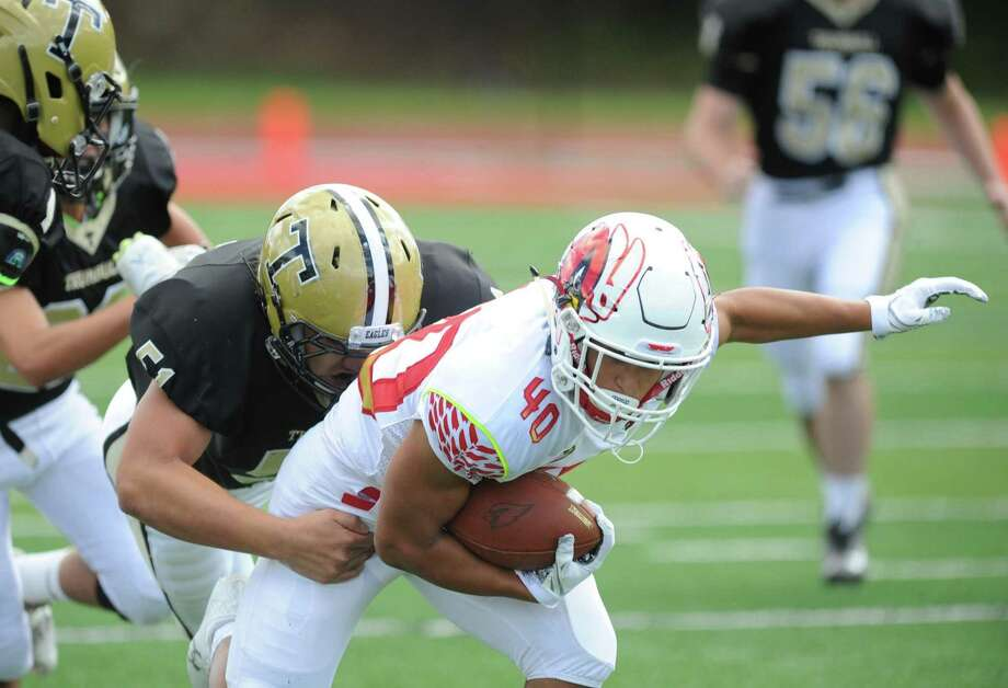 Greenwich, which beat Trumbull 70-16 in its opener, visits 1-0 Trinity Catholic on Saturday. Photo: Bob Luckey Jr. / Hearst Connecticut Media / Greenwich Time