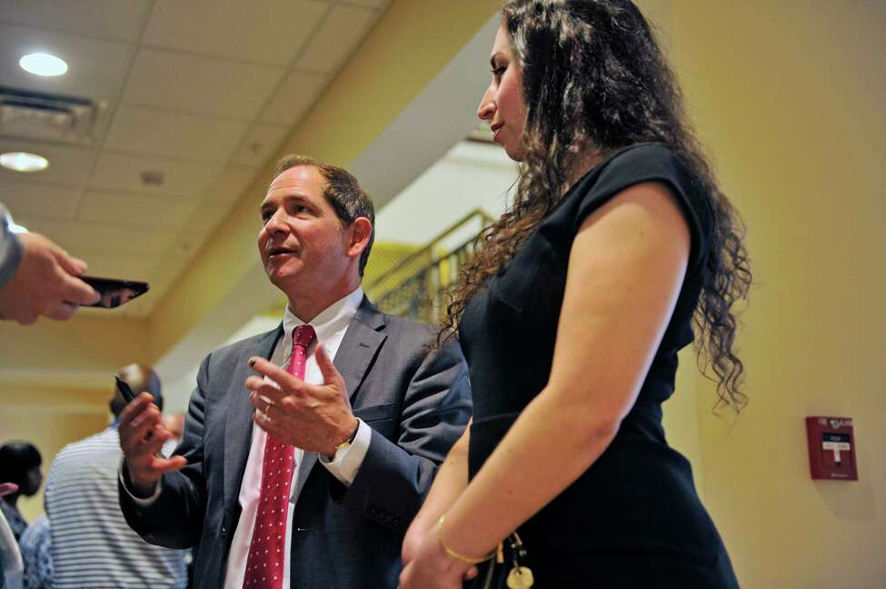 Glenn Garber, left, and Rebecca Freedman, with The Exoneration Initiative, talk about the cases of Lavell Jones and Carl Dukes at the Albany County Judicial Center on Thursday, July 7, 2016, in Albany, N.Y. The Exoneration Initiative worked on the case of Jones and Dukes. (Paul Buckowski / Times Union)