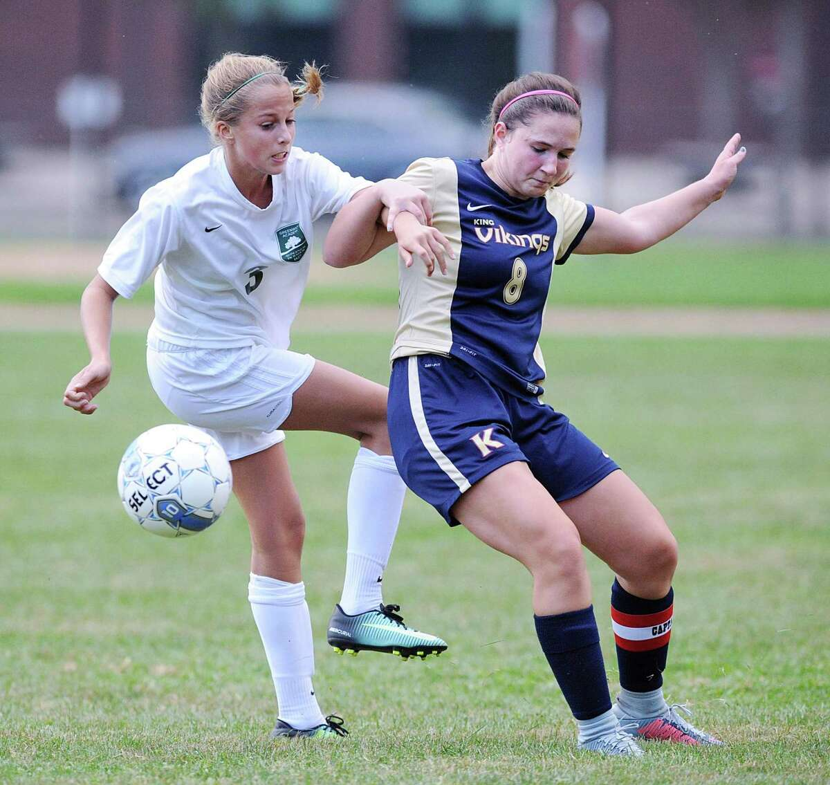 Greenwich Academy's Katie Goldsmith, left, mixes it up with King's Hope Deschapelles (#8) as the two vied for a loose ball during the girls high school soccer match between King School and Greenwich Academy at King in Stamford, Conn., Thursday, Sept. 14, 2017. GA defeated King, 6-0.