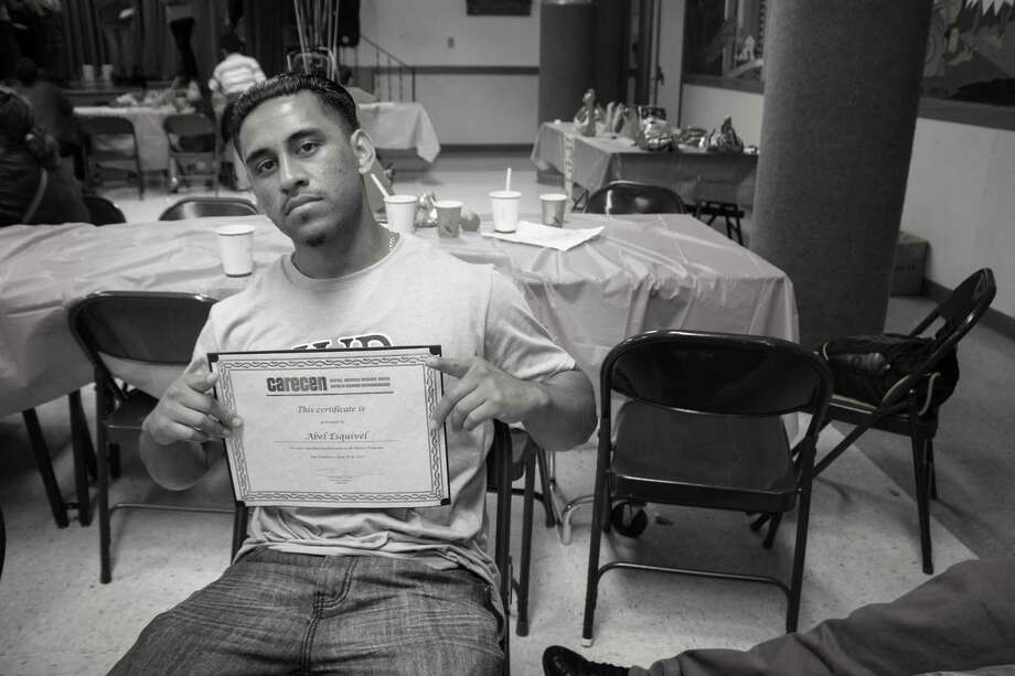 Abel Esquivel poses with a certificate from the Central American Resource Center in San Francisco's Mission District, where he worked as a summer intern. Esquivel was killed on Aug. 15 with a gun that was stolen from a city police officer's vehicle. Photo: Central American Resource Center / /
