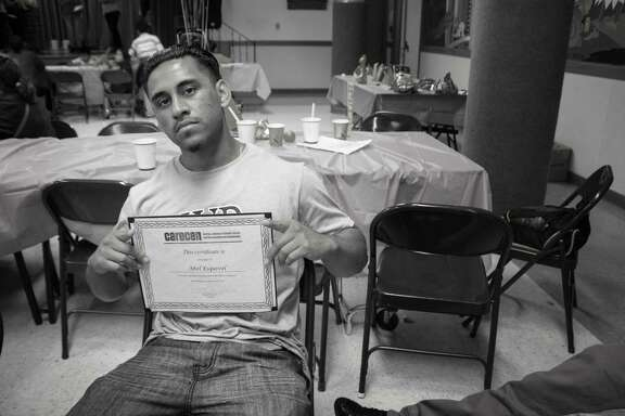 Abel Esquivel poses with a certificate from the Central American Resource Center in San Francisco's Mission District, where he worked as a summer intern. Esquivel was killed on Aug. 15 with a gun that was stolen from a city police officer's vehicle.