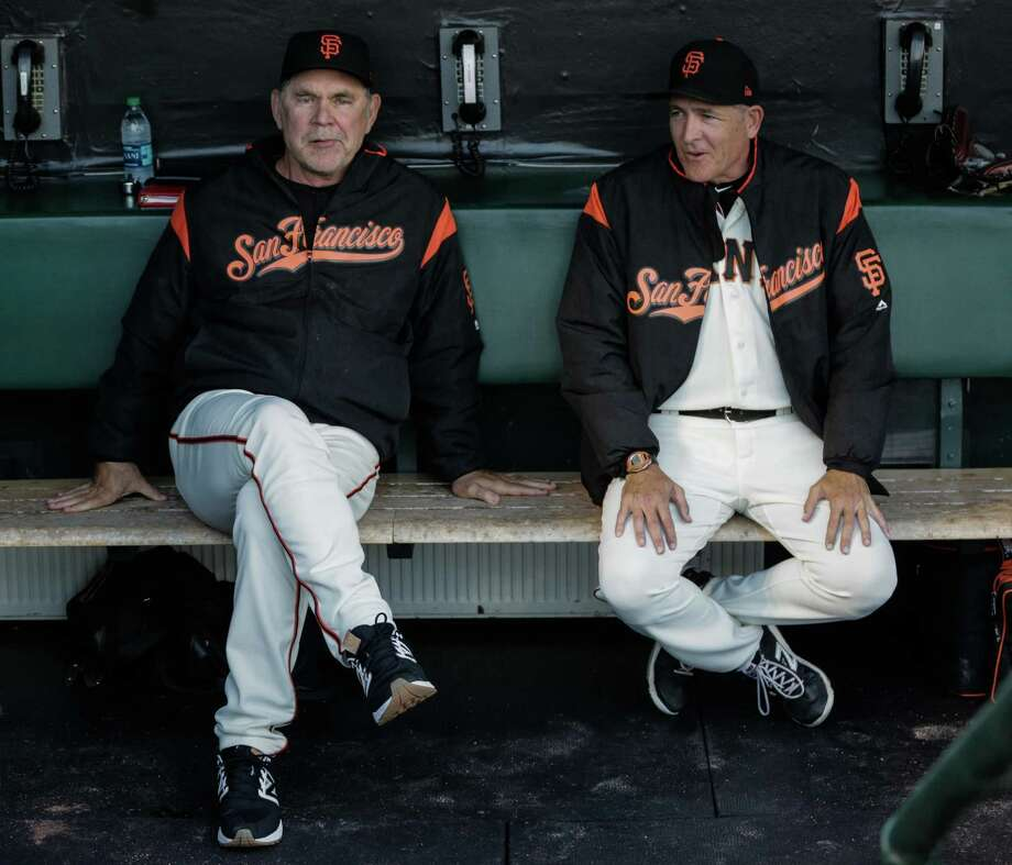 Giants' manager Bruch Bochy (left) chats with pitching coach Dave Righetti in August. Photo: Gabrielle Lurie / The Chronicle / ONLINE_YES