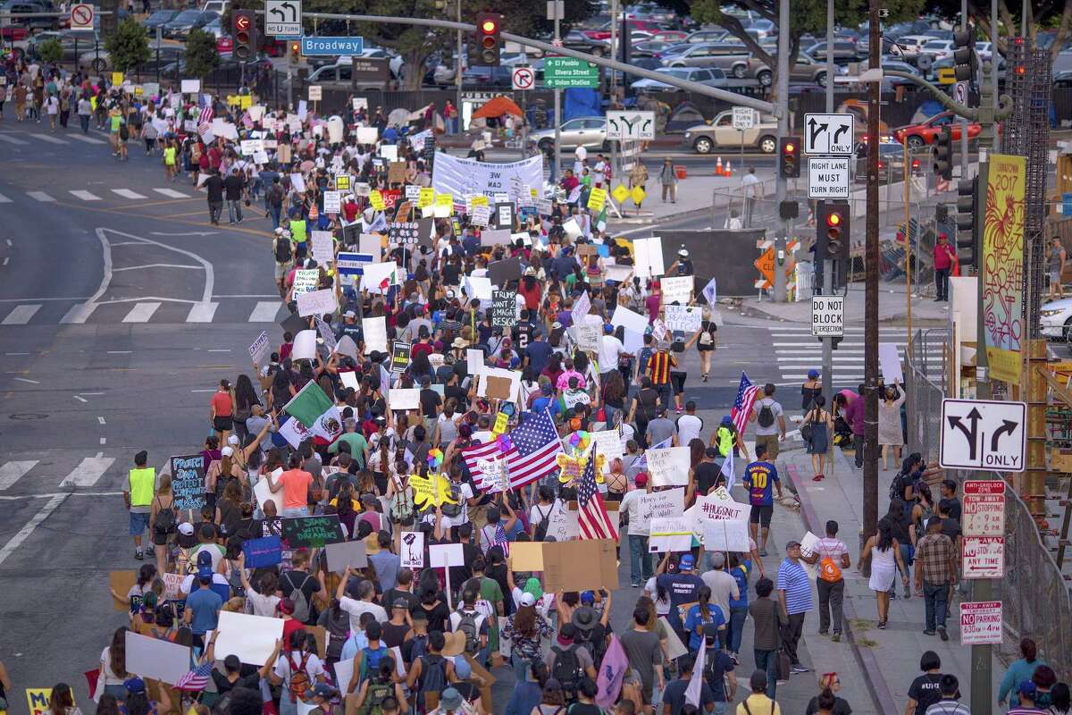 Thousands of immigrants and supporters join the