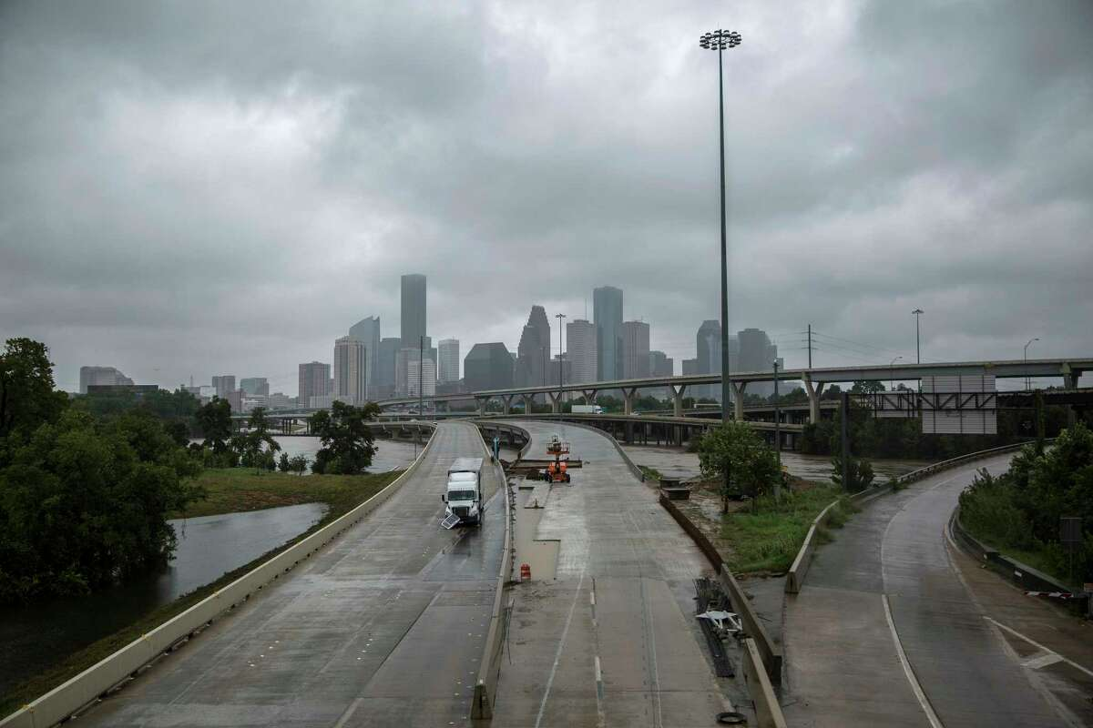 An abandoned truck remains on Interstate 45 in Houston on Aug. 29 in the wake of flooding caused by Hurricane Harvey. (Tamir Kalifa/The New York Times)