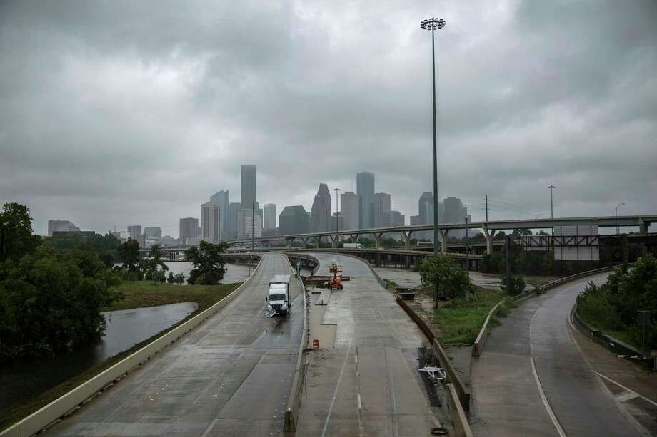 An abandoned truck remains on Interstate 45 in Houston on Aug. 29 in the wake of flooding caused by Hurricane Harvey.  (Tamir Kalifa/The New York Times) Photo: TAMIR KALIFA, STR / NYTNS