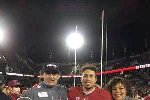 Stanford wide receiver J.J. Arcega-Whiteside poses after a 2016 home game with his brother, Keenan; father, Joaquin Arcega, and mother, Valerie Whiteside.