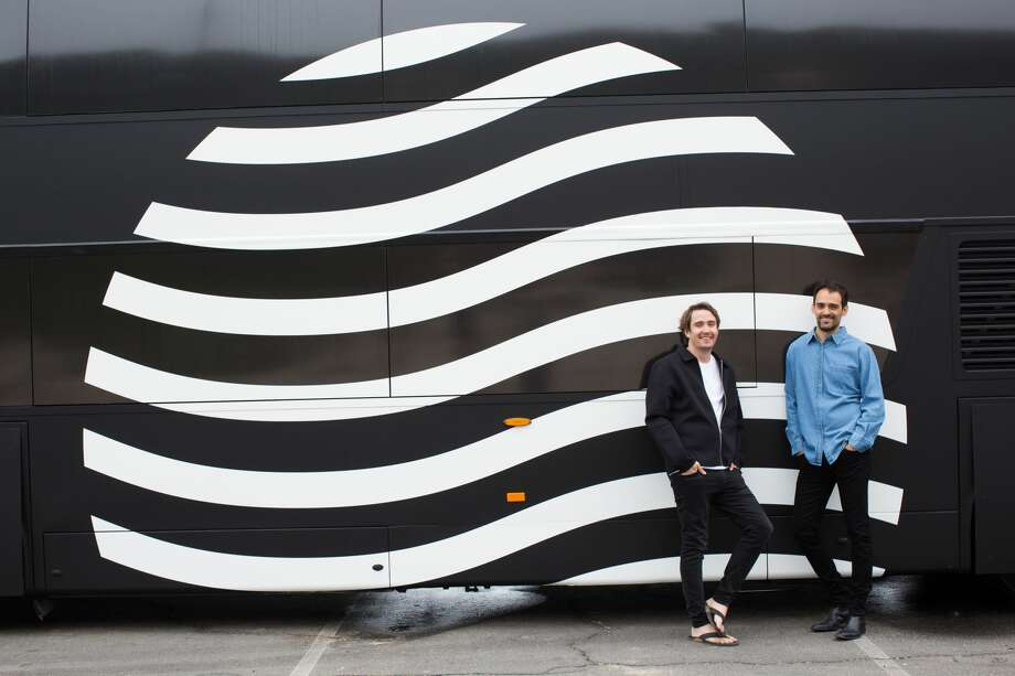 Cabin co-founders Tom Currier and Gaetano Crupi stand in front of the company's bus. Photo: Courtesy Of Cabin