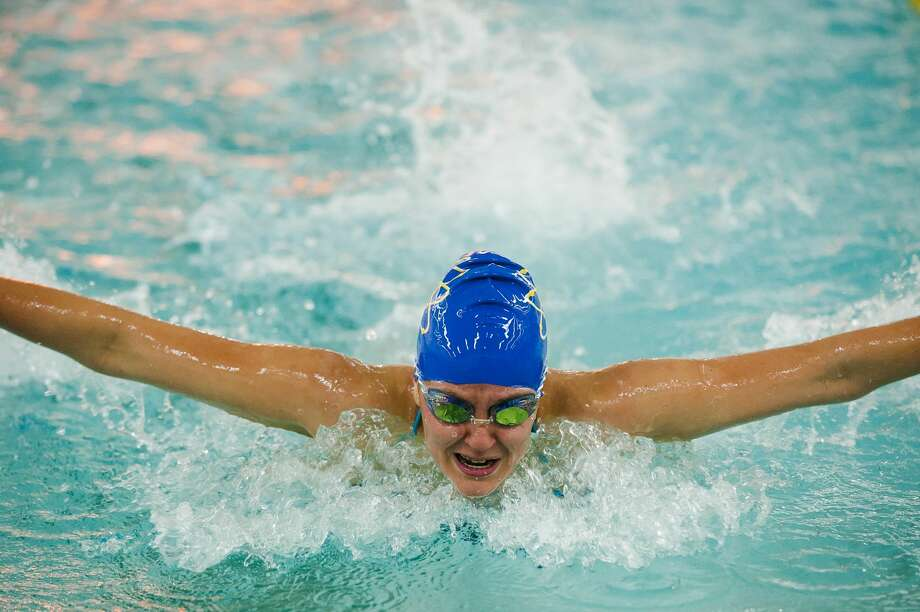 Midland's Delaney Randall competes in the 100 yard butterfly during Midland's swim meet against Saginaw Heritage on Thursday, September 14, 2017 at H. H. Dow High School. (Katy Kildee/kkildee@mdn.net) Photo: (Katy Kildee/kkildee@mdn.net)