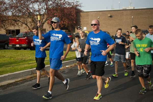 Runners take off during the Law Enforcement Torch Run for Special Olympics Michigan on Thursday, September 14, 2017 at the Midland Law Enforcement Center. (Katy Kildee/kkildee@mdn.net)