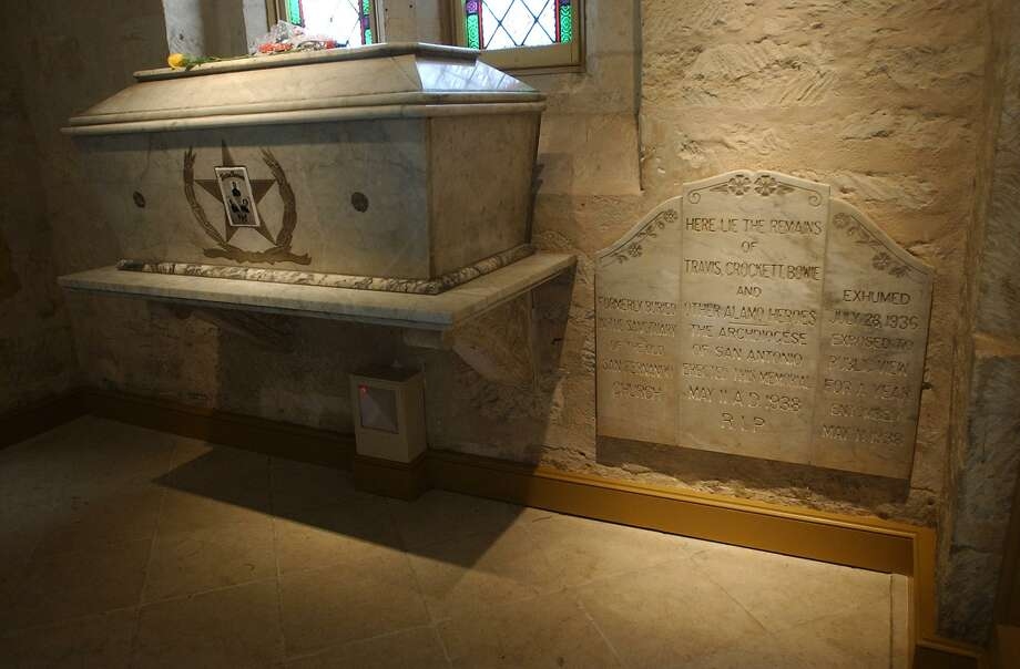 It has been said that the sarcophagus in the entrance at the San Fernando Cathedral contains the remains of defenders of the Alamo whose bodies were burned after the 1836 battle. That belief was advanced by Archbishop Arthur J. Drossaerts, based on late recollections of Juan Seguin. Historical experts have said the remains are not likely Alamo defenders, but possibly fallen participants of the 1813 Battle of Rosillo. Photo: William Luther / San Antonio Express-News / SAN ANTONIO EXPRESS-NEWS