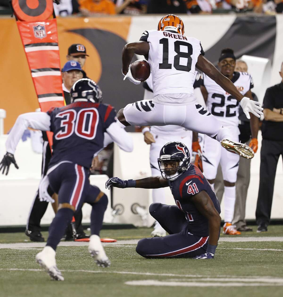 Cincinnati Bengals wide receiver A.J. Green (18) jumps over Houston Texans linebacker Zach Cunningham (41) during the first quarter of an NFL football game at Paul Brown Stadium on Thursday, Sept. 14, 2017, in Cincinnati. ( Brett Coomer / Houston Chronicle )