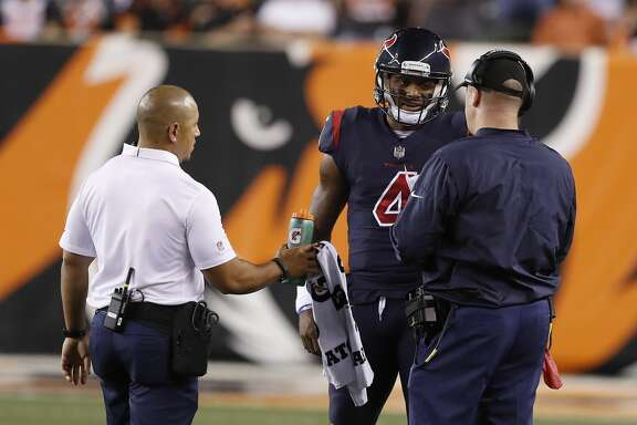 Houston Texans quarterback Deshaun Watson (4) talks with head coach Bill O'Brien between plays during the first quarter of an NFL football game at Paul Brown Stadium on Thursday, Sept. 14, 2017, in Cincinnati. ( Brett Coomer / Houston Chronicle )
