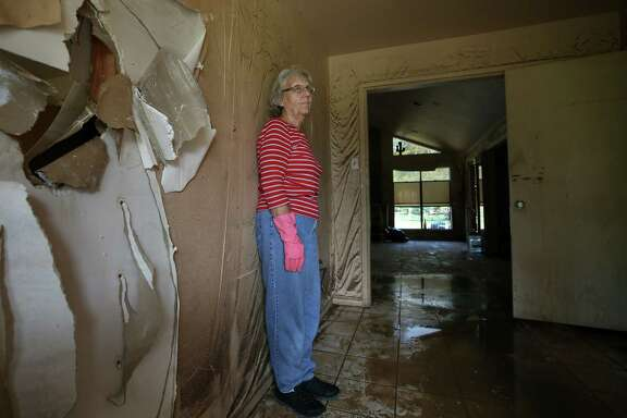 """I thought we were going to drown,""Linda Holmes says, recalling the night her Wharton home flooded."