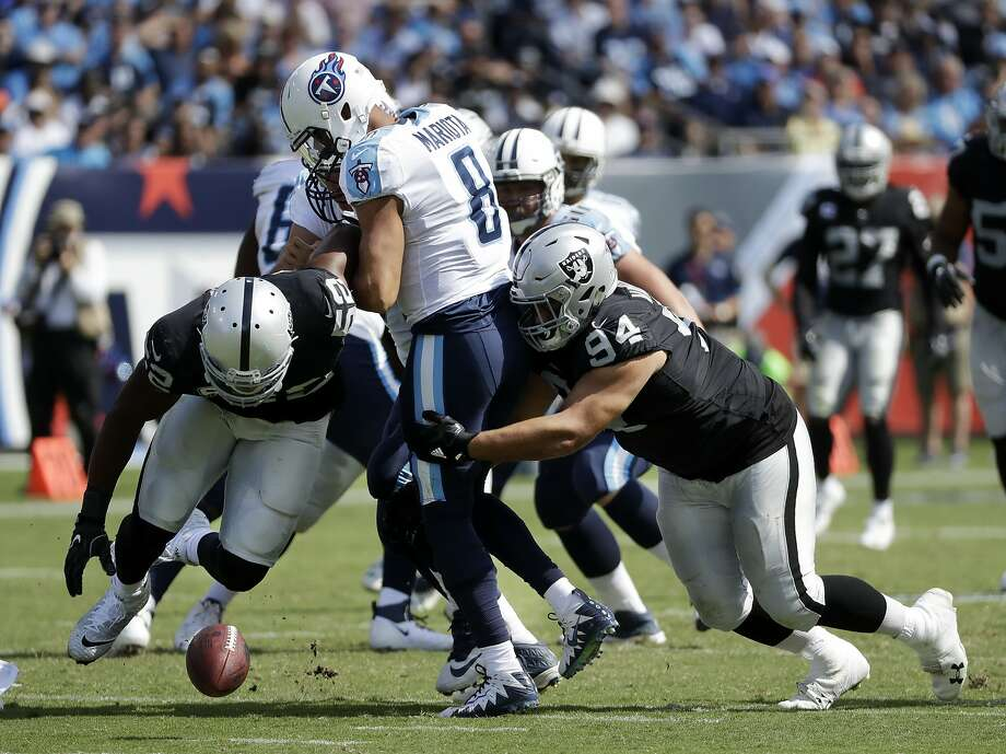 Oakland Raiders defensive end Khalil Mack (52) and defensive tackle Eddie Vanderdoes (94) chase after a fumble by Tennessee Titans quarterback Marcus Mariota (8) in the second half of an NFL football game Sunday, Sept. 10, 2017, in Nashville, Tenn. Photo: James Kenney, Associated Press