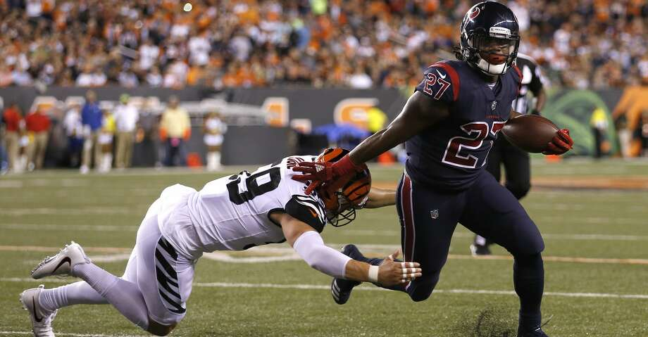 Houston Texans running back D'Onta Foreman (27) tries to shake a tacke by Cincinnati Bengals outside linebacker Nick Vigil (59) during the first quarter of an NFL football game at Paul Brown Stadium on Thursday, Sept. 14, 2017, in Cincinnati. ( Brett Coomer / Houston Chronicle ) Photo: Brett Coomer/Houston Chronicle