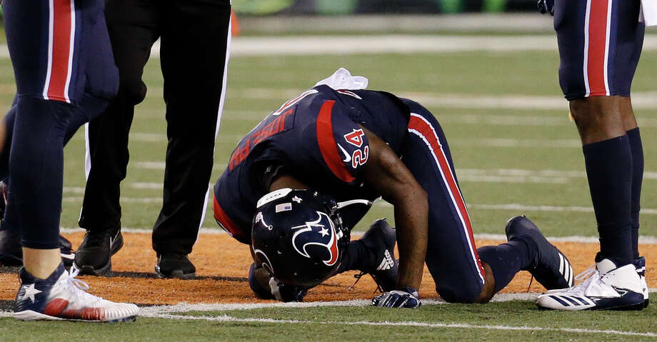 Houston Texans cornerback Johnathan Joseph (24) kneels on the field after an apparent injury in the first half of an NFL football game against the Cincinnati Bengals, Thursday, Sept. 14, 2017, in Cincinnati. (AP Photo/Frank Victores) Photo: Frank Victores/Associated Press