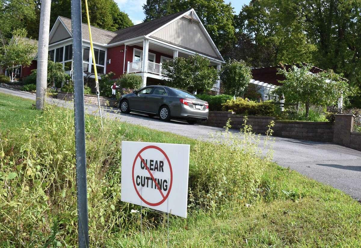 "A ""no clear cutting"" sign is seen in front of Barbara Faraone's home on Saratoga Lake. (Lori Van Buren / Times Union)"
