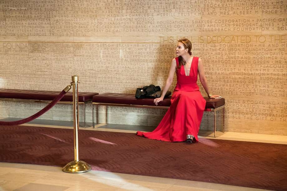 Sara Steingart sits in the lobby of Davies Symphony Hall while waiting for someone before the start of the San Francisco Symphony Opening Night Gala in San Francisco, Calif., on Thursday, September 14, 2017. Photo: Laura Morton, Special To The Chronicle
