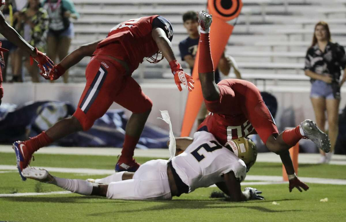 Klein Collins Tigers Omar Harewood (2) rushes for a touchdown defended by Lamar Texans Isaiah Ibeto (42) and Lamar Texans Zion Burrell (20) during the high school football game between Klein Collins Tigers and the Lamar Texans at Delmar Stadium in Houston, TX on Thursday, September 14, 2017.
