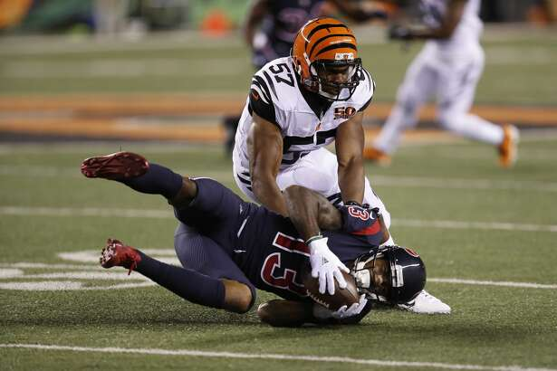 Cincinnati Bengals outside linebacker Vincent Rey (57) stops Houston Texans wide receiver Braxton Miller (13) during the second quarter of an NFL football game at Paul Brown Stadium on Thursday, Sept. 14, 2017, in Cincinnati. ( Brett Coomer / Houston Chronicle )