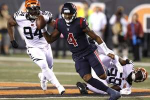 Houston Texans quarterback Deshaun Watson (4) scrambles out of the pocket past Cincinnati Bengals linebacker Carl Lawson (58) and defensive end Chris Smith (94) on his way to a 49-yard touchdown run during the second quarter of an NFL football game at Paul Brown Stadium on Thursday, Sept. 14, 2017, in Cincinnati. ( Brett Coomer / Houston Chronicle )